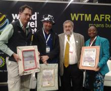 Coffeebeans director Iain Harris, in the hat, receives the African Responsible Tourism Award